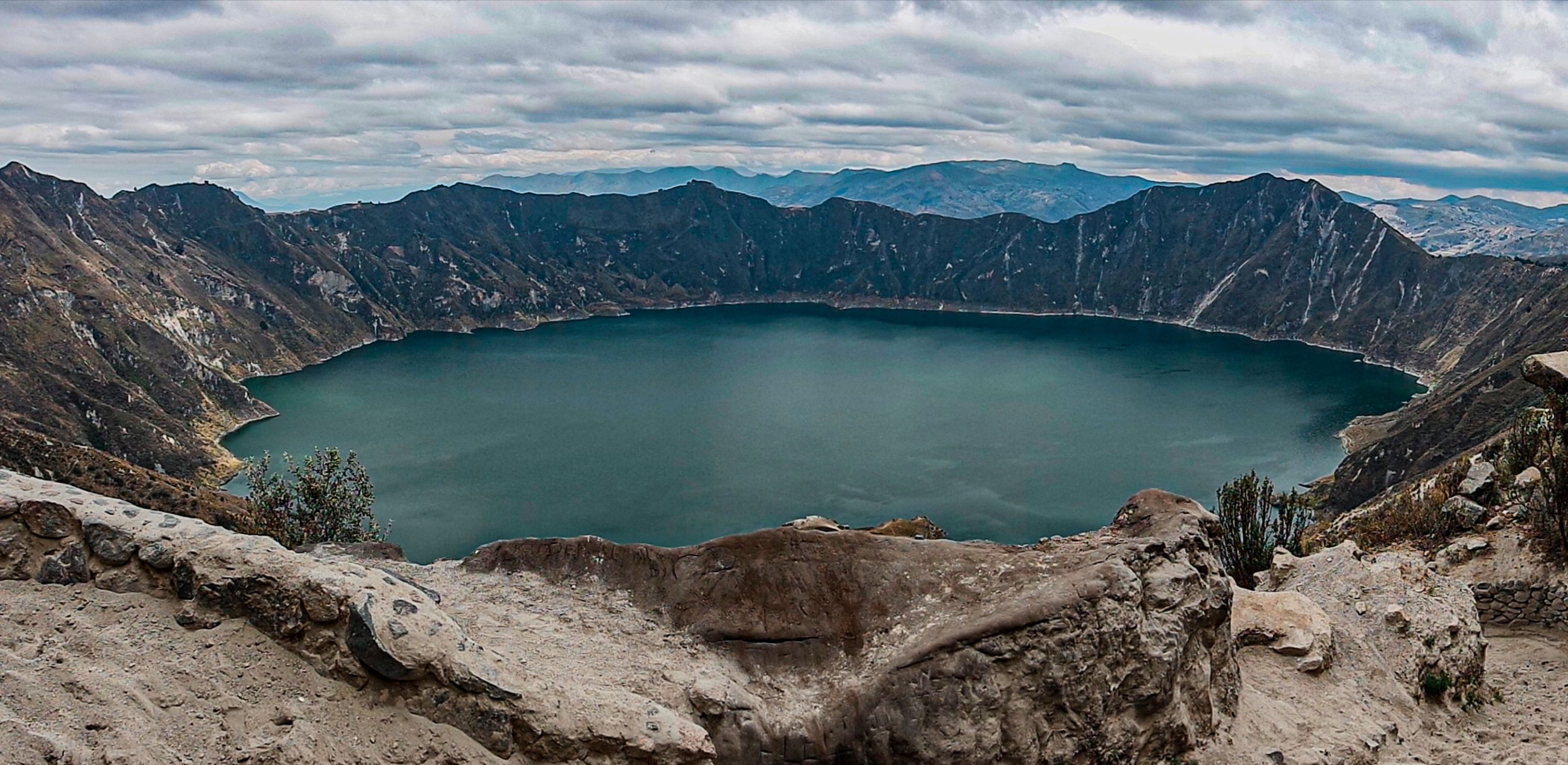 mountain, landscape, environment, water, scenics - nature, crater lake, lake, wilderness, cloud, nature, beauty in nature, sky, travel destinations, land, travel, mountain range, geology, volcano, no people, volcanic crater, tourism, reservoir, outdoors, activity, non-urban scene, panoramic, tranquility, reflection, rock, high angle view, blue, day, tranquil scene, social issues, leisure activity, ridge