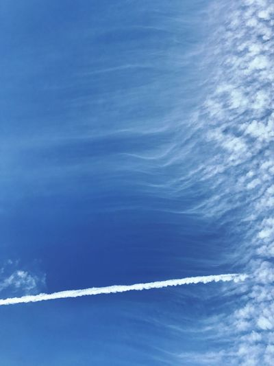Sky Vapor Trail Blue Cloud - Sky Nature Low Angle View Beauty In Nature Day Backgrounds No People Outdoors Scenics Contrail Water