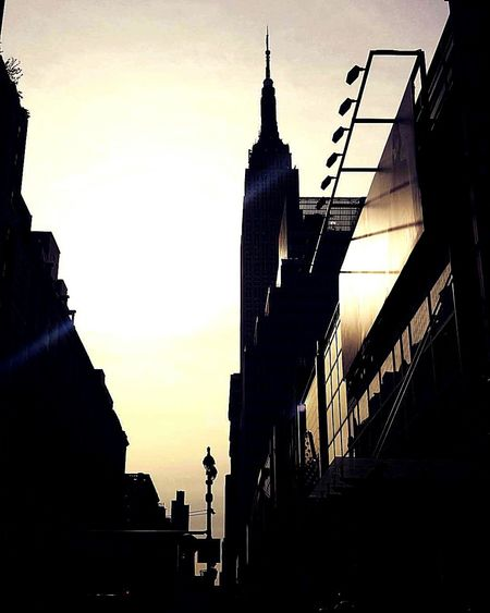Sun rises on the Em EyeEmNewHere NYC LIFE ♥ Midtown Manhattan City Modern pire. Empire Of Lights Empiretower Times Square NYC Bryant Park NYC Cityscape Arts Culture And Entertainment Silhouette The Architect - 2017 EyeEm Awards The Great Outdoors - 2017 EyeEm Awards The Street Photographer - 2017 EyeEm Awards