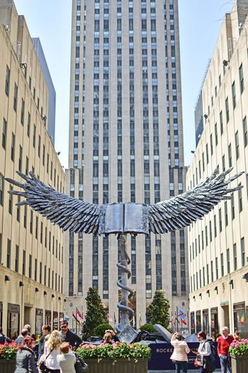 Wings Rockerfellercenter Architecture Building Exterior Built Structure City Building Office Building Exterior Motor Vehicle Street Modern Tall - High Incidental People Land Vehicle Travel Mode Of Transportation Nature Transportation Day Car Office Skyscraper