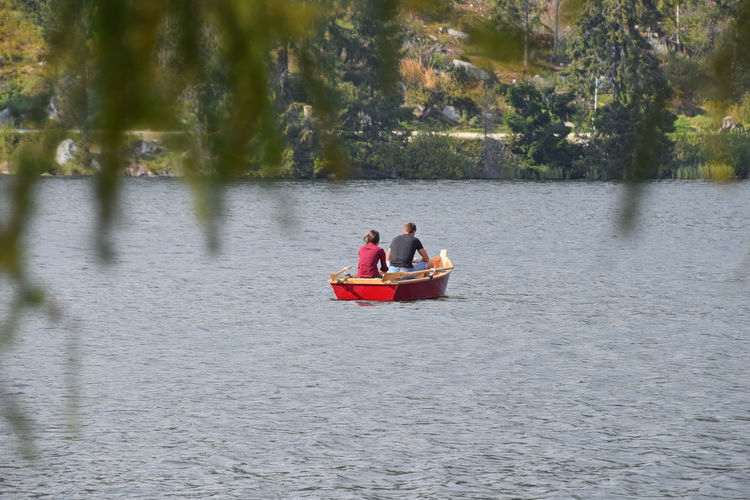 Couple boating at Strbske Pleso (Štrbské Pleso) mountain lake in Vysoke Tatry (High Tatras) mountains, Slovakia Alone Boat Boating Couple Getting Away From It All Leisure Activity Lifestyles Nature Pull Remote Row Sailing Scenics Strbske Pleso Tatra Mountains Tatry Together Togetherness Tranquil Scene Tranquility Tree Vacation Water Waterfront Let's Go. Together. Summer Exploratorium