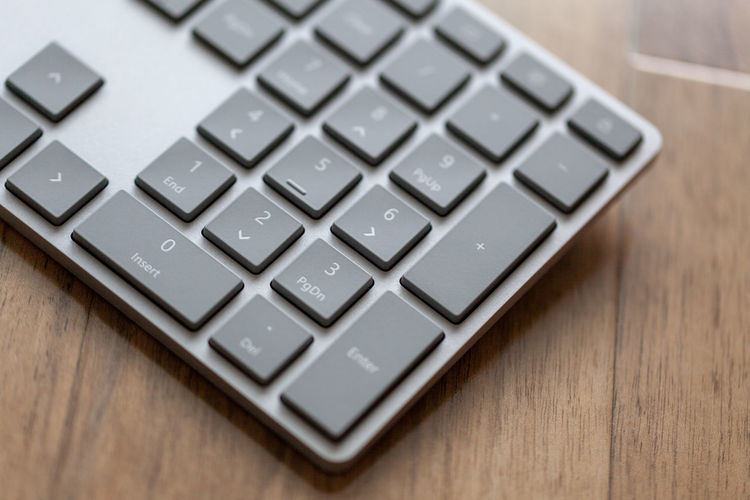 Close-up of laptop keyboard on table