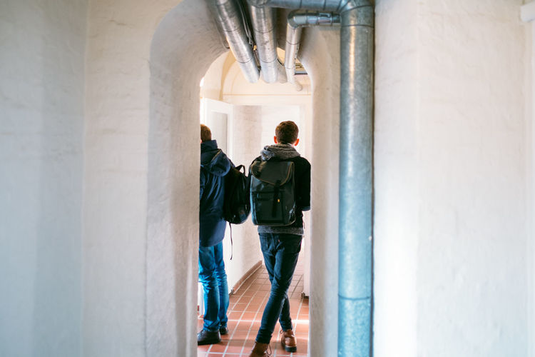 Berlin Dome  Berliner Dom Arcade Arch Architectural Column Architecture Building Built Structure Casual Clothing Corridor Day Full Length History Indoors  Lifestyles Men People Real People Rear View Standing The Past Wall - Building Feature