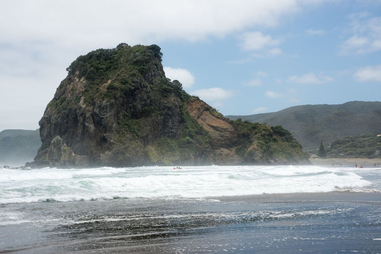Piha Beach's Lion Rock with volcanic black sand and Tasman Sea waves in Auckland, New Zealand Auckland Lion Rock Tasman Sea Beach Beauty In Nature Black Eroded Flowing Water Geology Landmark Mountain Mountain Peak Nature New Zealand Piha Power In Nature Rock Rock - Object Sand Scenics - Nature Sea Solid Volcano Water Wave