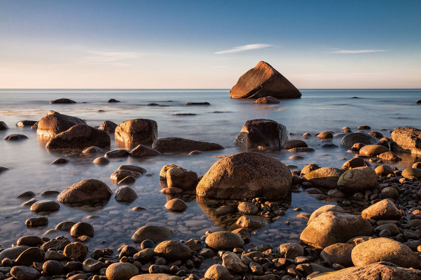 Stones on shore of the Baltic Sea. Beach Boulders Coast Day Holiday Landscape Lohme Nature Nature No People Outdoors Ruegen Rügen Schwanenstein Shore Sky Stones Sunset Tourism Travel Vacation