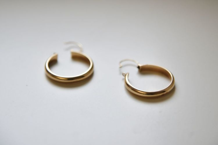 Close-up of wedding rings on metal against white background
