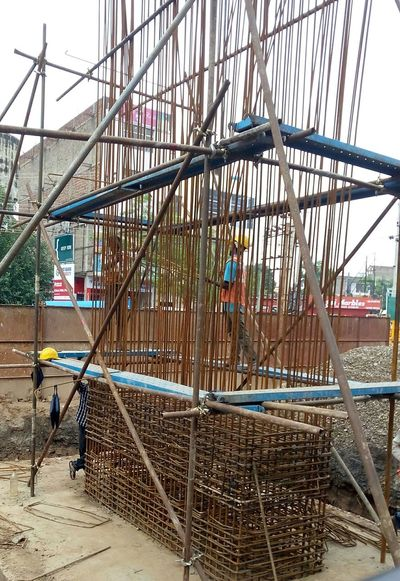 Hard Work With Hazard Worker Architecture Building Exterior Built Structure Construction Site Metalwork Outdoors Real People Real People, Real Lives Unsafe Unsafe Act Work At Height Workers At Work