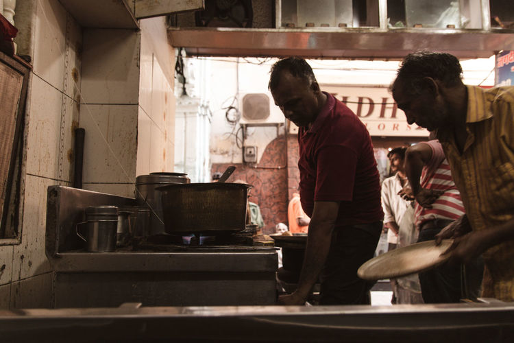 People working in kitchen