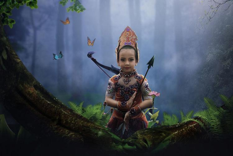 Portrait Of Girl Against Trees