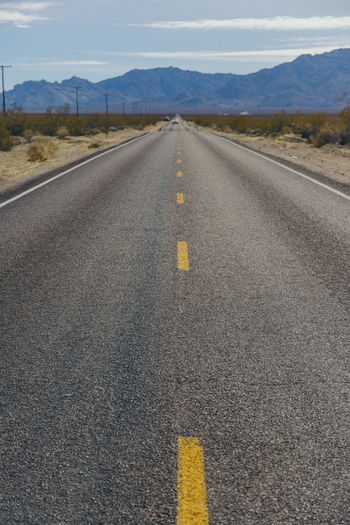 Asphalt Day Dividing Line Landscape Mountain Mountain Range Nature No People Outdoors Road Road Marking Sky Straight The Way Forward Transportation