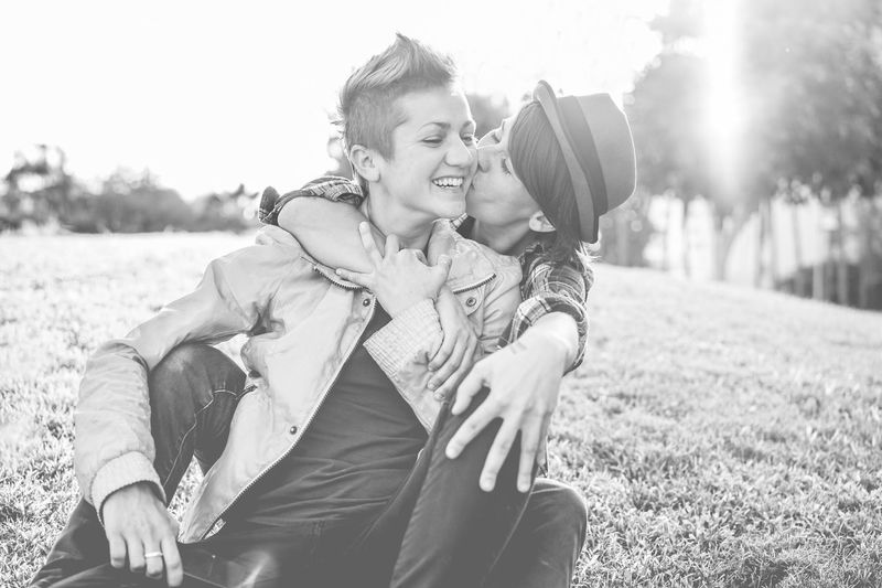 Happy female gay couple kissing and having fun together outdoor Couple Kiss Love Black Couple - Relationship Day Emotion Females Gay Happiness Homosexuals Lesbian Lgbt Lifestyles Pride Smiling White Women