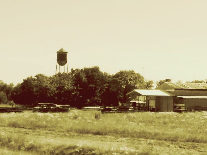 Water Tower Metal Barn Barn Scrap Scrap Metal Field Ditch Trees Old Look Photography Taking Photos The Great Outdoors - 2016 EyeEm Awards The Photojournalist - 2016 EyeEm Awards