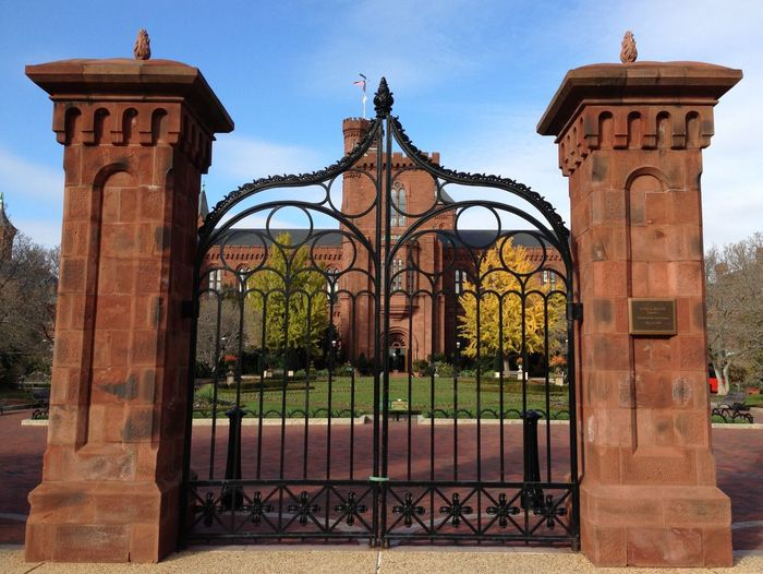 Gates at the Smithsonian Castle Gate Entrance Day Outdoors Wrought Iron Sky Architecture Built Structure No People Building Exterior Brick Museum