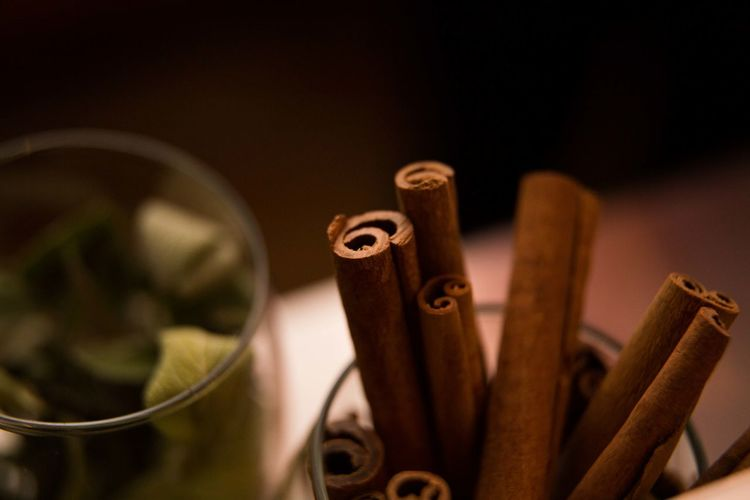 Glass of cinnamon sticks and leaves