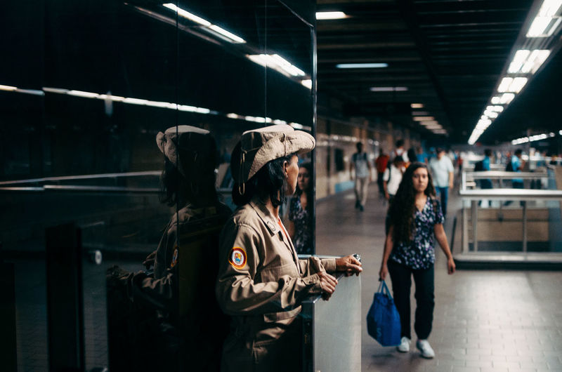 Meet Metro Militia EyeEm Best Shots EyeEm Selects Street Photography Streetphotography Waiting Communication Mode Of Transportation Travel Group Of People Standing Leisure Activity Casual Clothing Illuminated Architecture Rail Transportation Railroad Station Indoors  People Transportation Public Transportation Lifestyles Adult Incidental People Women Real People The Art Of Street Photography The Street Photographer - 2019 EyeEm Awards