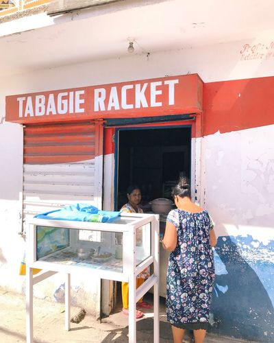 What's with all this bloody racket! Portrait Film Photography Film Mauritius EyeEm Gallery Eye4photography  EyeEm Selects EyeEm Best Shots Street Streetphotography Text People Business Small Business Adult Entrance Western Script Day Real People Two People Communication Women Architecture Lifestyles Food And Drink Store The Street Photographer - 2018 EyeEm Awards