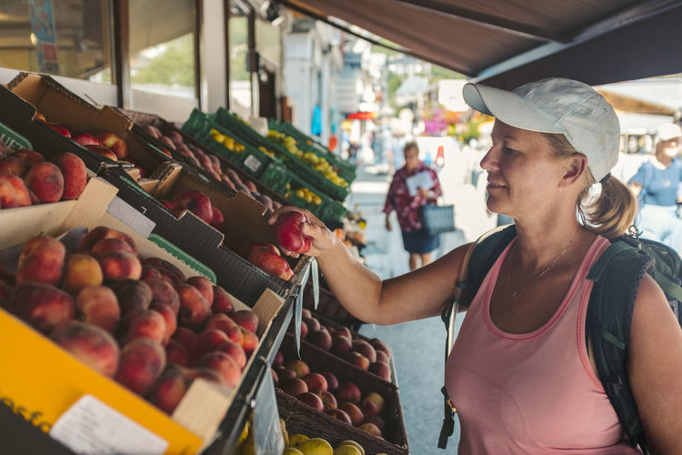 Midsection of woman at market stall
