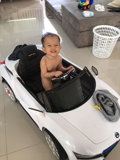 Looking At Camera One Person Portrait Smiling Indoors  People Child Headshot Sitting Happiness One Man Only Only Men Day Adult Young Adult Baby In Car