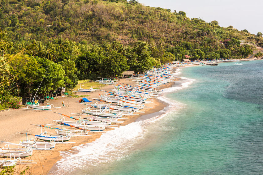 Coast around Ahmed in North Bali in Indonesia Ahmed Bali Beach Beauty In Nature Coast Day INDONESIA Landscape Nature No People Outdoors Sand Scenics Sea Sky Tourist Resort Tranquil Scene Travel Destinations Tree Vacations Water Waterfront