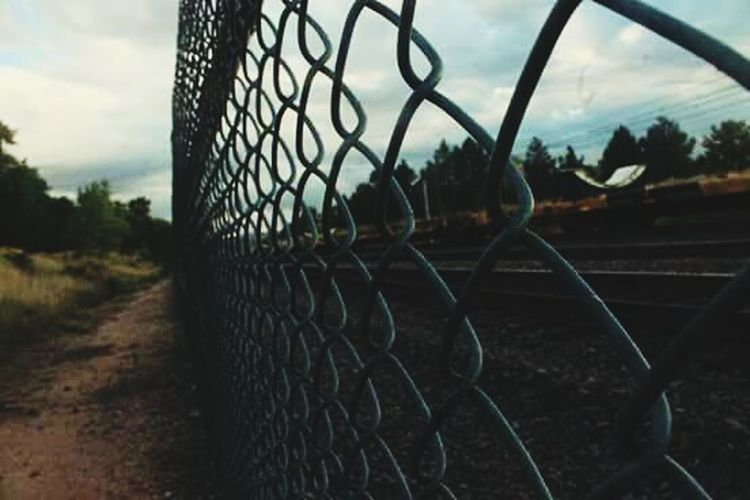 Fence Chainlink Fence Security Metal Sky Outdoors Train Train Tracks Protection Safety Barbed Wire Cloud - Sky Prison Wire Mesh Forbidden No People Nature Day Grass First Eyeem Photo