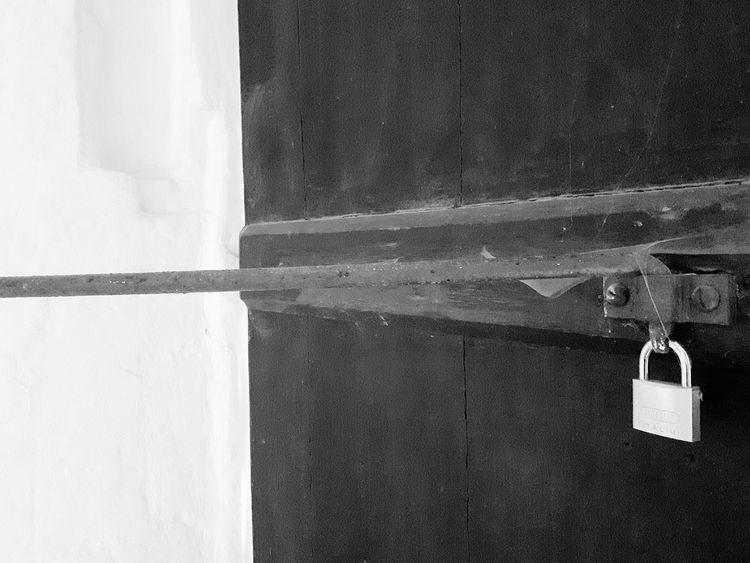 Door is open! (B&W) Monochrome Photography Monochrome Dark Blackandwhite Photography Silver Padlock Contrasting Colors Door Padlock Padlocks White Padlock Padlock On A Door Contrasts Lock Padlock On A Gate Door Lock Door Closer Doorlock White Contrast Gate Door Latch Locks Black TakeoverContrast Blackandwhite Black And White Friday