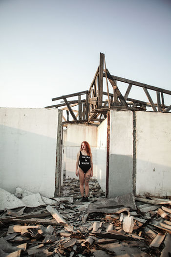 Young Woman Standing In Abandoned House