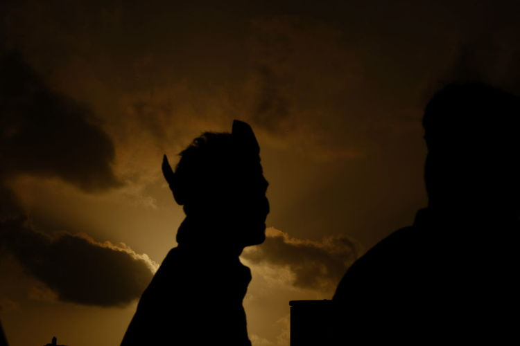 Portrait of silhouette people against sky during sunset