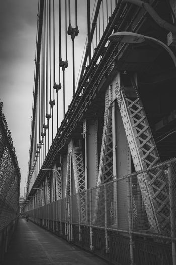 A view along the pedestrian path on Manhattan Bridge in New York City, NY, USA. Architectural Feature Architecture Black & White Blackandwhite Blackandwhite Photography Bridge - Man Made Structure Built Structure Day Diminishing Perspective Empty Engineering Manhattan Manhattan Bridge New York New York City No People Travel Destinations Vanishing Point