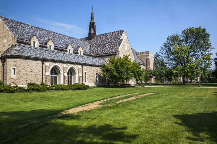 University of Notre Dame USA Color Blue Sky Culture Religion Christian Education Famous Green Knowledge Lawn Science And Technology Tree Campus Green Grass Horizontal Composition Sunny Day Teaching Building University Of Notre Dame USA