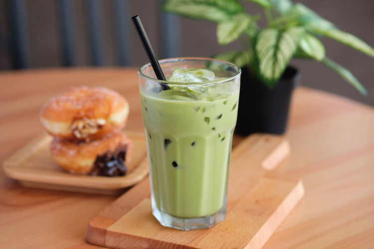 Food And Drink Food Drink Freshness Glass Refreshment Drinking Glass Healthy Eating Table Household Equipment Drinking Straw Fruit Straw Focus On Foreground Wellbeing No People Ready-to-eat Close-up Still Life Herb Temptation Garnish Breakfast Mint Leaf - Culinary Matcha Latte
