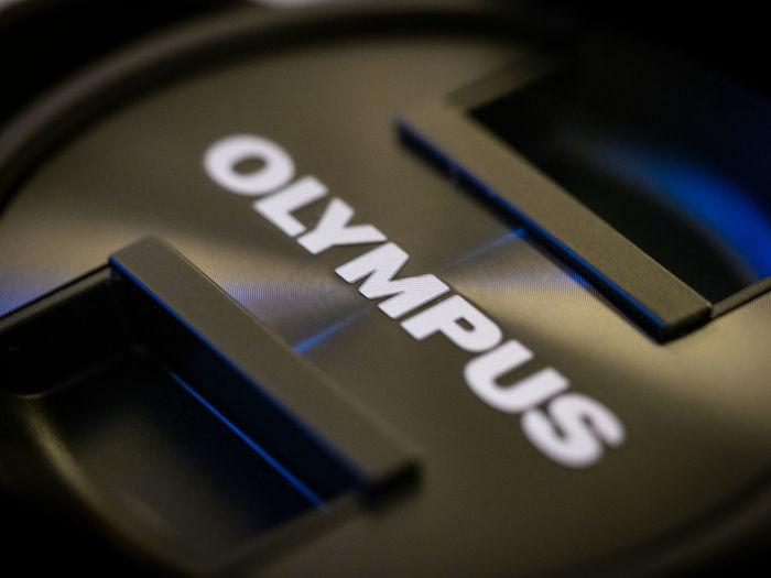 Olympus lens cap Brand Close-up Equipment Focus Focus On Foreground Fotography Lens Cap Macro Olympus Product Simple Colors Text