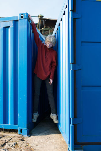 Woman between shipping containers