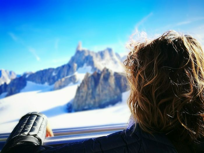 Rear View Of Woman Looking At Snowcapped Mont Blanc From Ski Lift