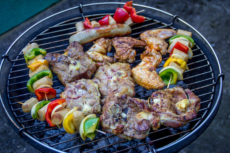 High angle view of meat and vegetables on barbecue