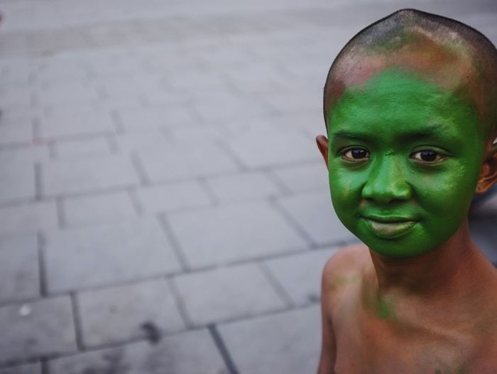 """Youth Of Today Portrait of Farhan """"the green face"""" . He is homeless boy and working as a street performance art to get money Streetphotography Urbanphotography Documentary Fujifilm"""