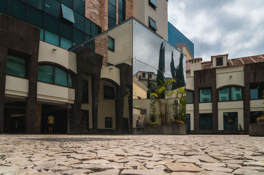 Square in Funchal Madeira Funchal Madeira Madeira Island Mirror Absence Architecture Building Building Exterior Built Structure City Cloud - Sky Cobblestone Day Low Angle View Mirror Reflection Nature No People Outdoors Palm Tree Residential District Sky Street Sunlight Tropical Climate Window