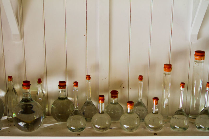 Close-up of glass bottles in row