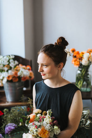 Woman looking at flower bouquet