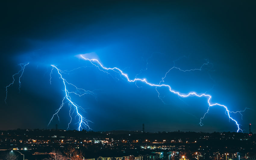ELECTRIC Lightning Power In Nature Storm Power Thunderstorm Night Cloud - Sky Architecture Forked Lightning Illuminated Sky City Beauty In Nature Building Exterior Nature Built Structure Sign Warning Sign Electricity  No People Cityscape Outdoors
