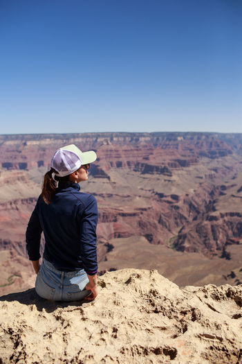 landscape Grand Canyon Nature Canyon X real people Travel Travel Photography Tranquility EyeEm Nature Lover The Canyon Landscape Grand Canyon Nature Real People Travel Travel Photography Tranquility EyeEm Nature Lover Rear View One Person Sky Scenics - Nature Environment Lifestyles Desert Land Outdoors Non-urban Scene Climate Arid Climate Hat Clear Sky USA Leisure Activity International Women's Day 2019