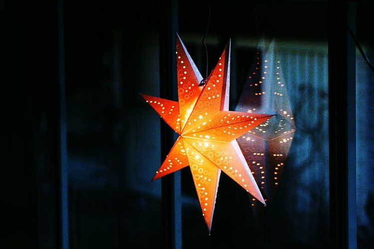 Close-up of illuminated star at night