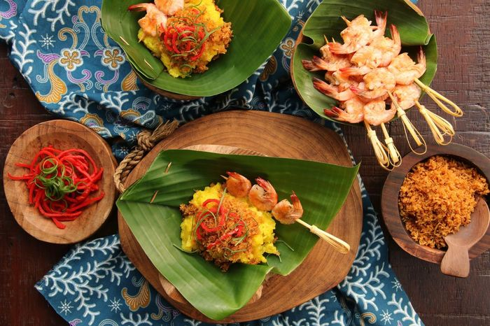Ketan Serundeng Udang, the Indonesian turmeric sticky rice with roasted coconut and shrimp satay. Vibrant Color Knolling Flat Lay Homemade Traditional Food INDONESIA Indonesian Food Batik Cloth Celebration Festive Shrimps Satay Red Chili Pepper Coconut Roasted Turmeric  Glutinous Rice Sticky Rice Banana Leaf Food Food And Drink Plate No People Freshness Healthy Eating Ready-to-eat Food Stories