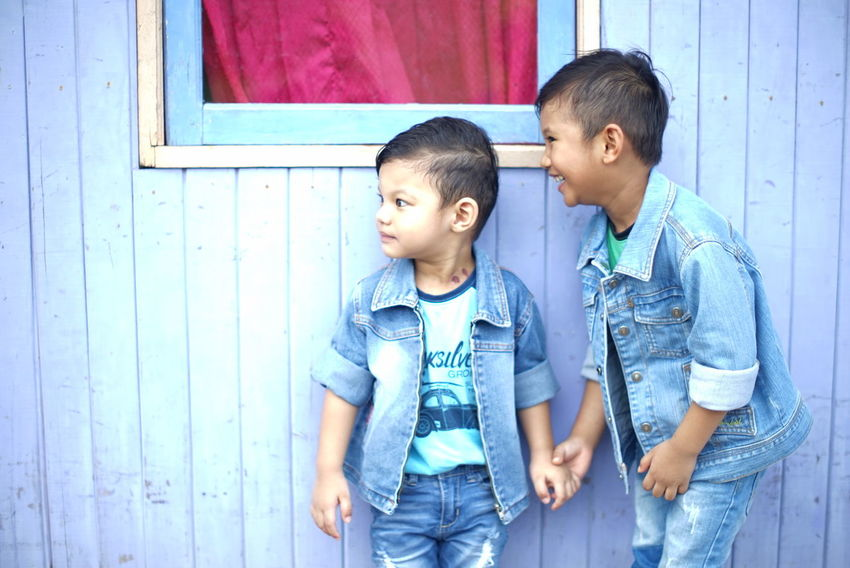 Brothers Brother Laughing Playing Together Siblings Boys Child Childhood Day Fashionable Outdoors People Smiling Two People Fashion Stories This Is Family