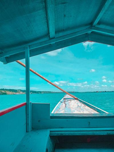 Scenic view of sea against blue sky perahu ojek padang kab.kepulauan selayar tanggal 12/11/2020