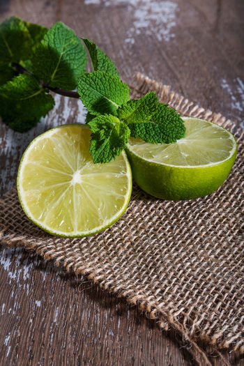 Lime with mint on rustic background