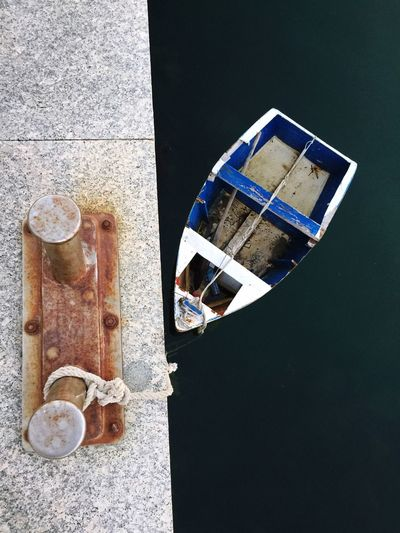 Directly above shot of rowboat tied up from bollard