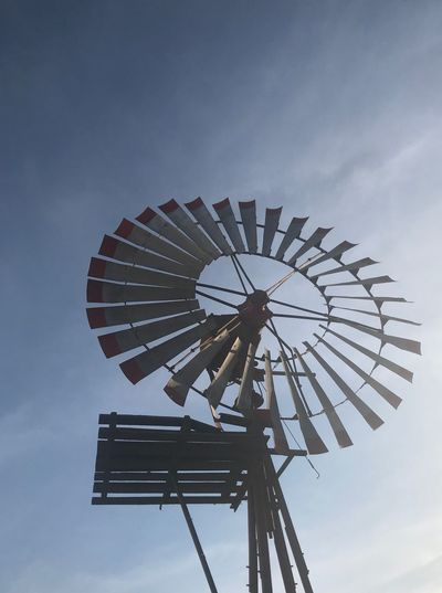 Old wind mill Low Angle View Sky Renewable Energy Environmental Conservation Fuel And Power Generation Alternative Energy Turbine Wind Turbine Wind Power Nature Environment Water Pump Amusement Park Ride Traditional Windmill Cloud - Sky Arts Culture And Entertainment No People Amusement Park Day Outdoors