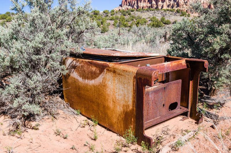 Old rusty metal on field