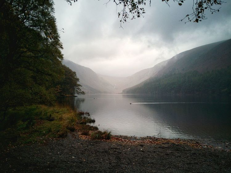 Upper Lake Glendalough. Glendalough Upper Lake Lake Mountain Water Nature Outdoors Landscape Day No People Valley Dramatic Landscape Refections In The Water Cloud Clouds And Sky Mountain Range Wicklow Ireland🍀 EyeEm Nature Lover EyeEmNewHere Huawei P10 Plus Autumn Colors 🍁🍂autumn 🍁🍂autumn Impression Lake View Lakeshore Lost In The Landscape