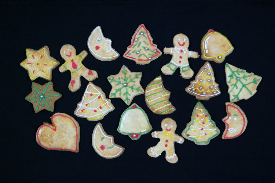 Baking Cookies Christmas Cookies Cookies Frosting Holiday Celebrations Black Background Christmas Decoration Christmas Tree Close-up Day Flat Lay Gingerbread Cookie Gingerbreadman High Angle View Indoors  Large Group Of Objects Multi Colored Studio Shot Sweet Food Winter Holidays